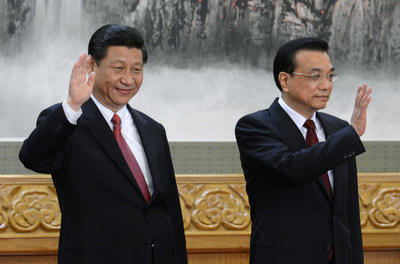 Chinese President Xi Jinping and Premier Li Keqiang wave at a press conference at the Great Hall of the People in Beijing. (Photo: AAP)