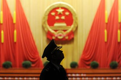 A member of the Chinese military band looks on before the closing session of the National People