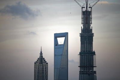 The Shanghai Tower is under construction, tallest, next to the Shanghai World Financial Center, center, and Jinmao Tower, left, in the Lujiazui Financial District in Pudong, Shanghai, China, 14 July 2013. (Photo: AAP)
