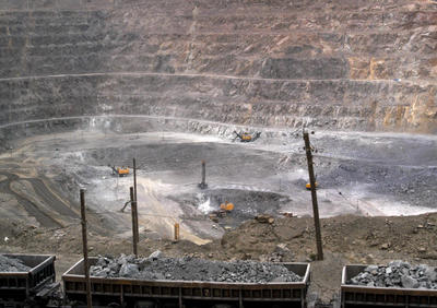 In this photo taken on 6 July 2010, workers use machinery to dig at a rare earth mine in Baiyunebo mining district of Baotou. (Photo: AAP)