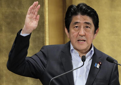 Japanese Prime Minister Shinzo Abe delivers a speech during a seminar in Tokyo Wednesday, June 5, 2013. (Photo: AAP)