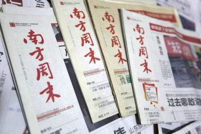 Past issues of Southern Weekly newspapers are pictured in Beijing, China, 08 January 2013.  (Photo: AAP)