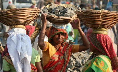 Female Indian labourers carry rocks at an road construction site on the outskirts of Siliguri on March 7, 2008, on the eve of International Womens Day. (Photo: AAP)