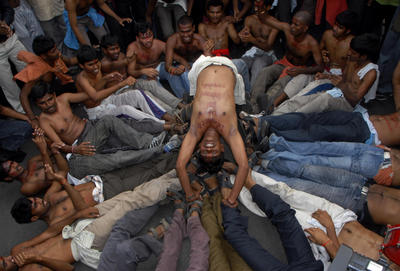 This photo from 2009 shows protestors demanding the formation of a new state called Telangana in the northern part of Andhra Pradesh state. The protestors lie on the road in Hyderabad. Four years later and Telangana has become the 29th state of India. (Photo: AAP)