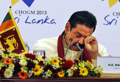 Sri Lankan President Mahinda Rajapaksa rubs his eye during a media briefing on the final day of the Commonwealth Heads of Governments Meeting (CHOGM) in Colombo, Sri Lanka, Sunday, 17 November 2013. (Photo: AAP)