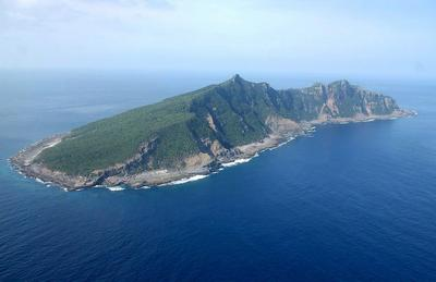 A file picture dated 27 April 2005 shows an aerial view of Uotsuri Island, one of the disputed Senkaku islands in the East China Sea. (Photo: AAP)