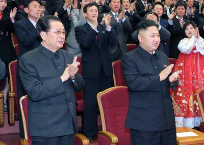 This picture taken by KCNA on 15 April 2013 shows Kim Jong Un (R) with his uncle Jang Sung Thaek, now executed.  (Photo: AAP)