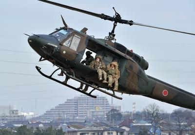 Abe's defence ambitions alarm region