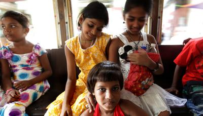 Liberated Indian child labourers enjoy a tram ride for the city on the World Day Against Child Labour on 12 June 2012. (Photo: AAP)