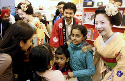 Two apprentice geisha from Kyoto appear at a cultural exchage event in New Delhi in India on 22 February 2014. (Photo: AAP)
