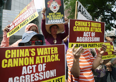Protesters picket the Chinese Consulate at the financial district of Makati city east of Manila, Philippines Monday, 3 March 2014, to protest the recent use of water cannons by the Chinese coast guard to drive away Filipino fishermen off the disputed Scarborough Shoal in the South China Sea. (Photo: AAP)
