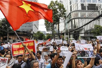 Anti-China protesters march while shouting slogans during a rally in downtown Ho Chi Minh city on 11 May 2014.  Protesters staged one of Vietnam