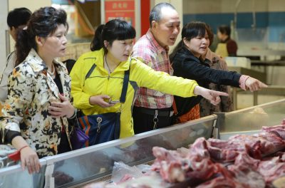 Shoppers at a market in Jiujiang city, in Jiangxi province, China. The upward trend in consumption should continue as rapid wage growth lifts household income. (Photo: AAP).