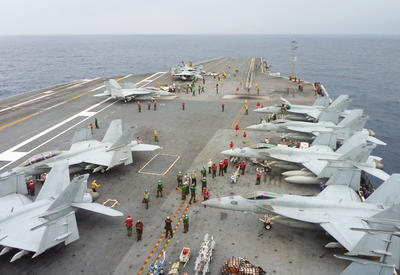 US Navy FA-18 Hornets cram the flight deck of the USS George Washington during a joint military exercise with Japan in the Pacific Ocean, 28 November 2013. (Photo: AAP).