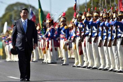 Chinese president Xi Jinping reviews the guard of honour upon his arrival at Planalto Palace in Brasilia, Brazil at the start of his tour of Latin America, 17 July 2014 in Brasilia. (Photo: AAP)