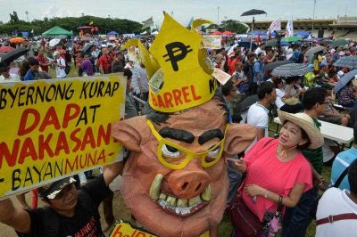 An effigy of Filipino president Benigno S. 'Noynoy' Aquino III is displayed as thousands of anti-corruption protesters march on the first year anniversary of an anti-graft street protest at a park in Manila, 25 August 2014. (Photo: AAP)