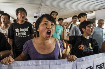 Students protesting for greater democratic rights march in Hong Kong on 24 September 2014. Striking students marched on Hong Kong's financial district, taking their protest to the city's commercial centre for the first time. (Photo: AAP).