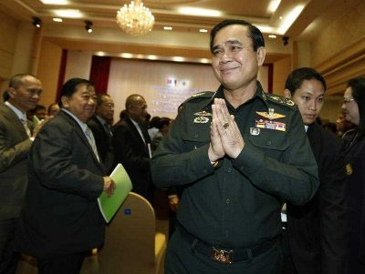 Thai military junta head and new Prime Minister General Prayuth Chan-ocha greets in the traditional Thai way as he leaves after a meeting of the instruction on the procedures of members of the national reform council at the Army Club in Bangkok, Thailand, 4 September 2014. (Photo: AAP).