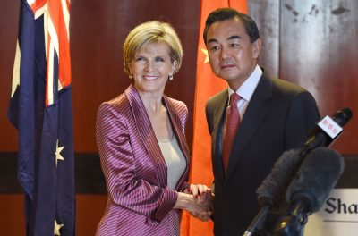 Australia's Minister for Foreign Affairs Julie Bishop and China's Foreign Minister Wang Yi shake hands after giving opening remarks before the next round of the Australia-China Foreign and Strategic Dialogue on 7 September 2014. (Photo: AAP).