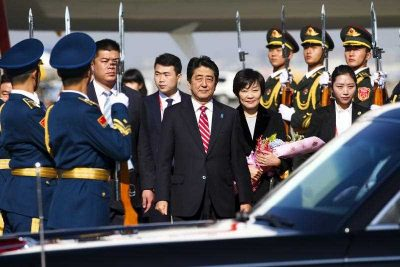 Japan's Prime Minister Shinzo Abe and his wife Akie arrive at Beijing Capital Airport in China on 9 November 2014. Abe is in China to attend the Asia Pacific Economic Cooperation (APEC) 2014 Summit and related meetings. (Photo: AAP).