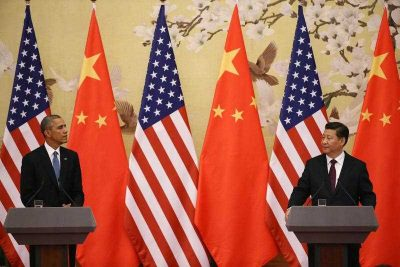 US president Barack Obama and Chinese president Xi Jinping look at each other during a press conference at the Great Hall of the People in Beijing during APEC, 12 November 2014. (Photo: AAP).
