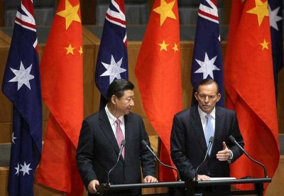 Chinese president Xi Jinping and Australian prime minister Tony Abbott speak at a press conference following the signing of several memorandums of understanding to strengthen trade in Canberra, 17 November 2014. (Photo: AAP).