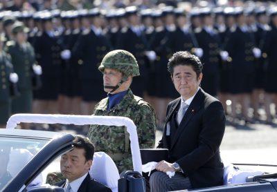 Prime Minister Shinzo Abe reviews members of Japan's Self-Defense Forces at Asaka Base, Tokyo, 27 October 2013. (Photo: AAP).