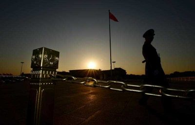 A Chinese paramilitary officer patrols Tiananmen Square after the Communist Party Central Committee's concluded its Third Plenum in Beijing on 12 November 2013. Implementation of the Third Plenum reforms that remove the shackles of the state in privileged sectors will create enormous new opportunities for private business, reduce waste of capital and lift medium term productivity and growth. (Photo: AAP).