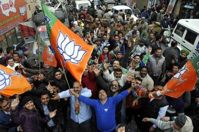 Bharatiya Janata Party (BJP) supporters celebrate the party victory as results continue to come in favor of BJP, in Jammu, the winter capital of Kashmir, India, 23 December 2014. (Photo: AAP)