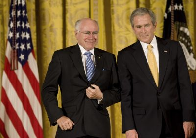 Former Australian Prime Minister John Howard and former President of the United States George Bush, in Washington, 2009. Australia and the United States have reduced their trade by US$53 billion with rest of the world and are worse off than they would have been without the Australia–United States free trade agreement. (Photo: AAP).