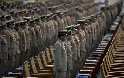 Military officers stand during Myanmar's 68th anniversary celebrations of Armed Forces Day on 27 March 2013. Engaging the military is essential in developing lasting reform. (Photo: AAP).