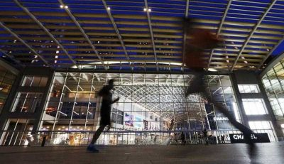 Joggers running outside The Shoppes at Marina Bay Sands, Singapore. (Photo: AAP).
