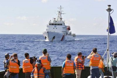 A Chinese government ship trails a Vietnamese Coast Guard vessel with reporters aboard in the South China Sea on July 15, 2014.  (Photo: AAP)
