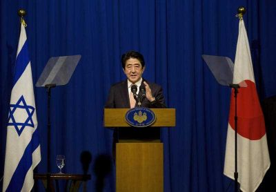 Japan's Prime Minister Shinzo Abe gestures as he speaks at a press conference in Jerusalem during a recent tour of the Middle East, 20 January 2015. (Photo: AAP).