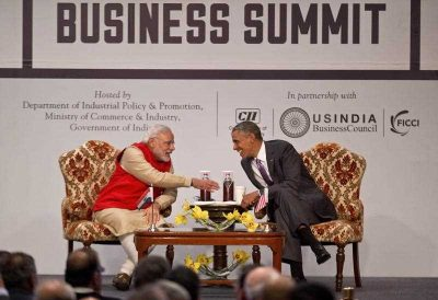 US President Barack Obama and Indian Prime Minister Narendra Modi interact during the India-US business summit in New Delhi, India, 26 January 2015. (Photo: AAP).