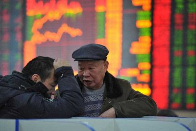 Chinese investors talk as they look at stock indices and prices of shares at a stock brokerage house in Fuyang city, China, 2 February 2015. (Photo: AAP).