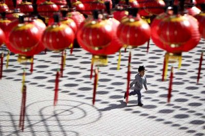 A boy runs at a temple casted with shadows of traditional Chinese lantern decorations ahead of the Chinese Lunar New Year in Kuala Lumpur, Malaysia, on Tuesday, 17 Feb 2015. (Photo: AAP)