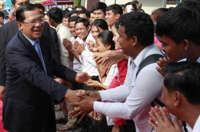Cambodian Prime Minister Hun Sen, greets well-wishers during the 36th anniversary of Victory Day, when the Khmer Rouge regime was toppled in Phnom Penh, Cambodia, 07 January 2015. (Photo: AAP).
