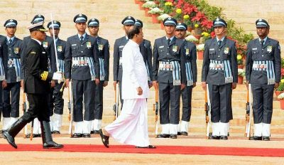 Sri Lanka's President Maithripala Sirisena inspects a guard of honor during his welcome reception at the Indian Presidential Palace, New Delhi. (Photo: AAP).