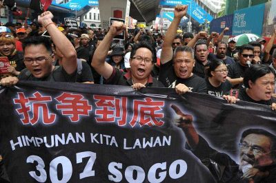 Thousands gather outside the Masjid Jamek LRT station on March 7, 2015 for a giant street rally to pressure the government to free jailed opposition leader Datuk Seri Anwar Ibrahimi in Kuala Lumpur, Malaysia. (Photo: AAP)
