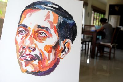A painting by Bali Nine ringleader Myuran Sukumaran of Indonesian President Jokowi Widodo with words on the back of the painting 'people can change'. (Photo: AAP).