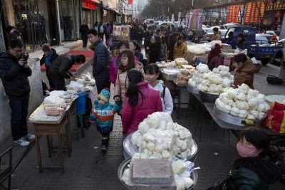 Residents visit a street market in Gujiao in northern China's Shanxi province. From coal country to the export-driven manufacturing heartland of China's southeast, millions of people are enduring wrenching economic change. (Photo: AAP).