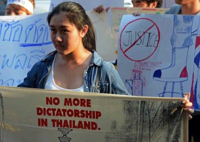 Thai students display placards as they demonstrate in front of the military court in Bangkok on 16 March 2015. (Photo: AAP)