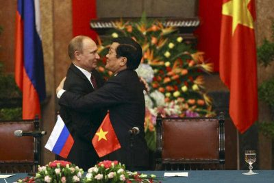 Russian President Vladimir Putin and Vietnamese President Truong Tan Sang embrace after the cooperation signing ceremony between Russia and Vietnam at the Presidential Palace in Hanoi, Vietnam on Tuesday 12 November 2013. (Photo: AAP).
