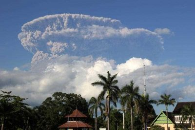 A giant cloud of ash and steam rises from the Sangeang Api volcano in Indonesia. The volcanic arc to the north of Australia poses the greatest risk to humanity. (Photo: AAP)