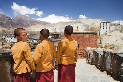 Looking homewards: novices at a Tibetan monastery in Mustang, Nepal. Many Tibetan exiles are banking on reforms in China to resolve the dispute. (Photo: Bartosz Hadyniak, iStock).