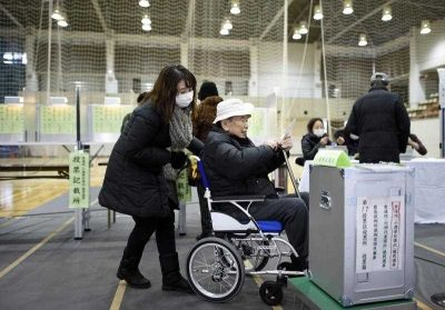 An elderly Japanese man on his way to cast his vote in 2014. The proportion of people aged 65 years old and over is now more than one-quarter of the total population of Japan — proportionally, the largest in the world. (Photo: AAP).