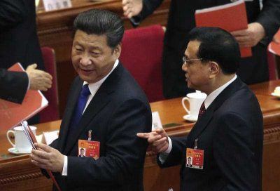 Chinese President Xi Jinping talks with Premier Li Keqiang after the closing session of the annual National People's Congress at the Great Hall of the People in Beijing, 15March 2015. (Photo: AAP).