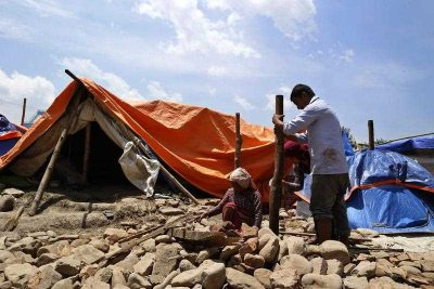 Nepalese earthquake survivors build a makeshift shelter at a devastated area in Bungamati, Nepal, 14 May 2015.  (Photo: AAP)
