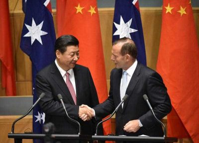 China's President Xi Jinping shakes hands with Australia's Prime Minister Tony Abbott after statements to the media following the signing of a free trade agreement at Parliament House in Canberra on 17 November 2014. (Photo: AAP).